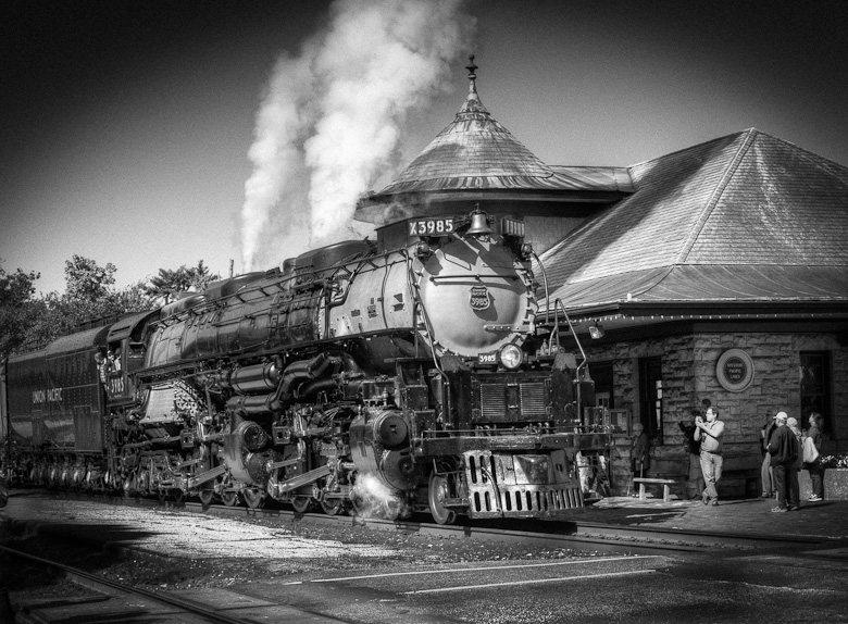 A UP steam locomotive makes a whistle stop at Kirkwood, Missouri.